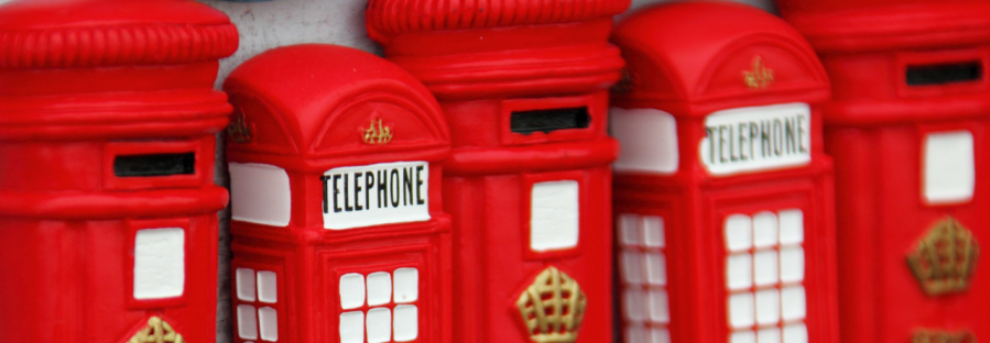 Red London phone box and postbox magnets lined up