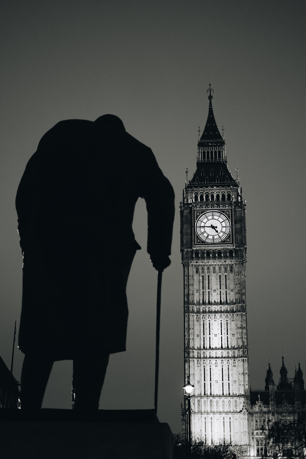 Statue of Winston Churchill outside Big Ben at night